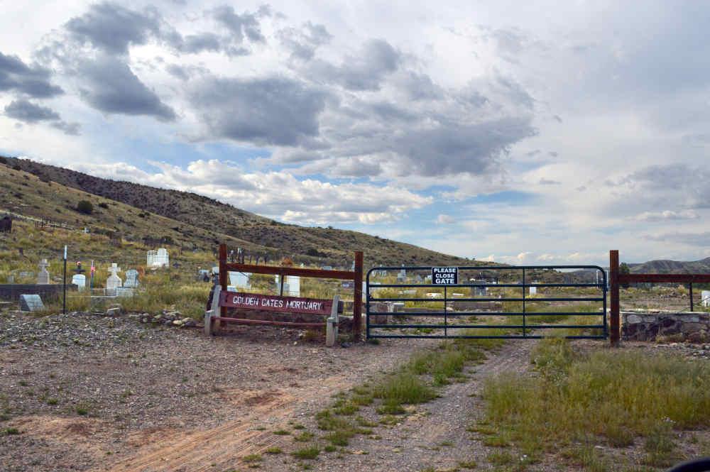 Golden Gates Mortuary bench outside the Monticello Cemetery near Monticello New Mexico
