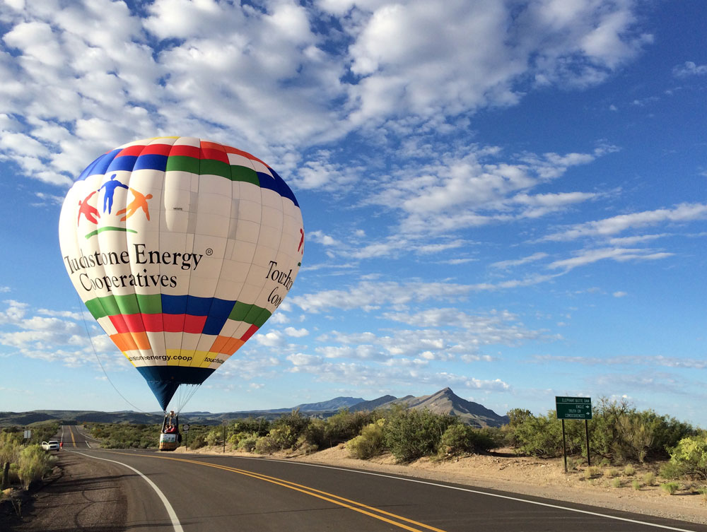 Elephant Butte Balloon Regatta 2016 - a balloon touches down on Highway 195