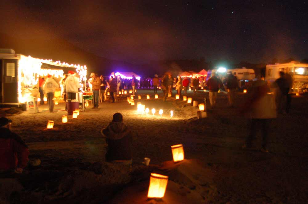 crowds enjoying the Luminaria Beachwalk in Elephant Butte New Mexico