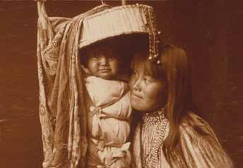 Apache mother and child in cradleboard - Edward S. Curtis [Public domain], via Wikimedia Commons