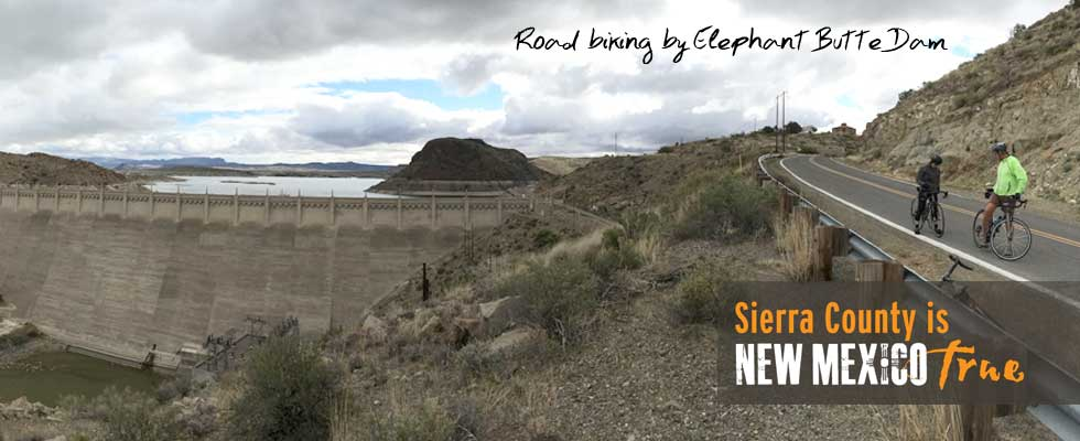 road bikers check their gear near Elephant Butte Dam