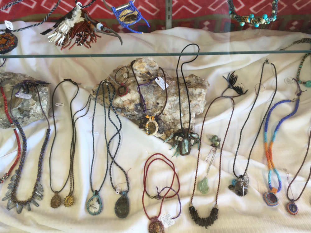 necklaces in a display case at Junkology