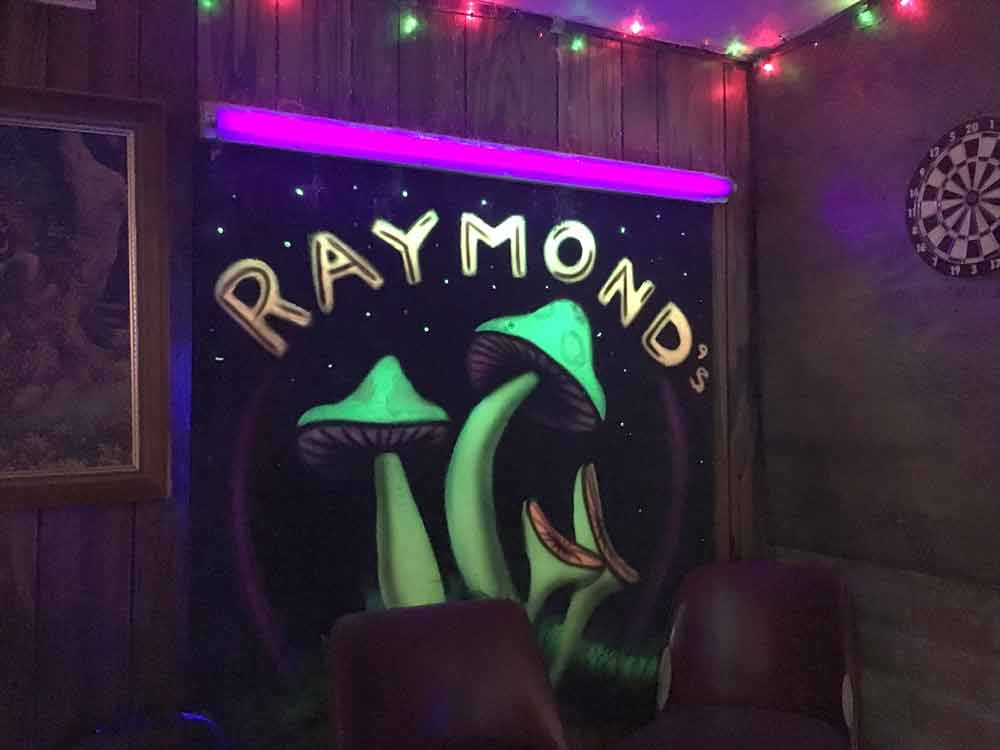 dart board and blacklight painting at Raymond's Lounge in Truth or Consequences