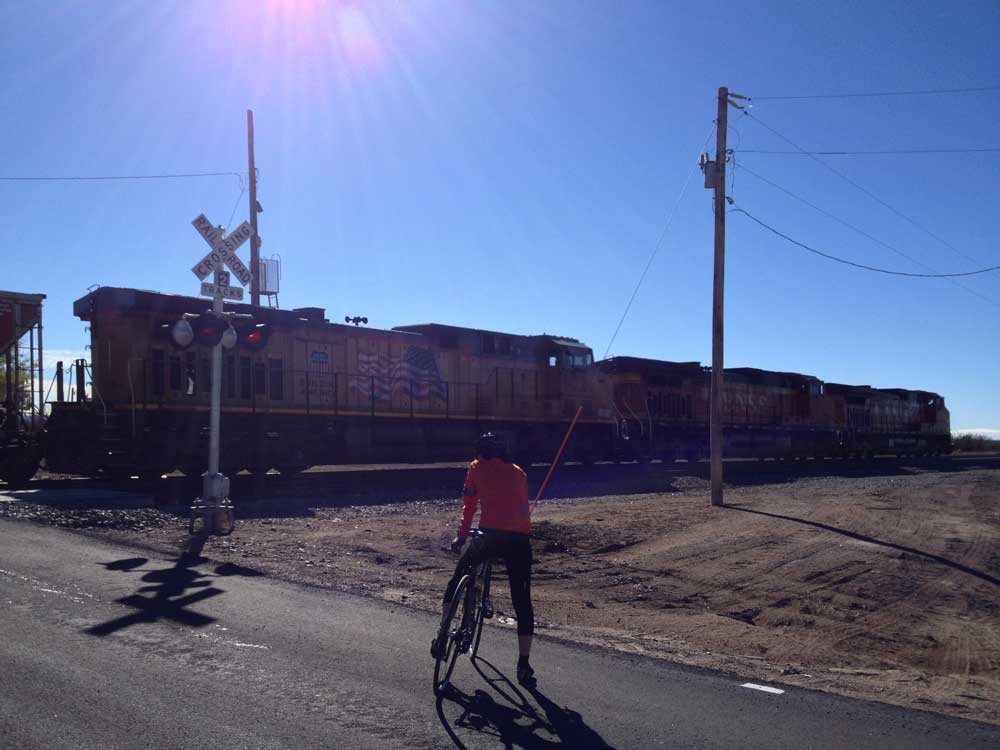 train crossing in Engle with road biker