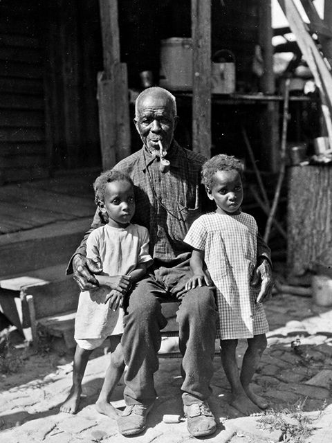 Cudjo Lewis and his Great Grandaugthers twin 1928.jpg