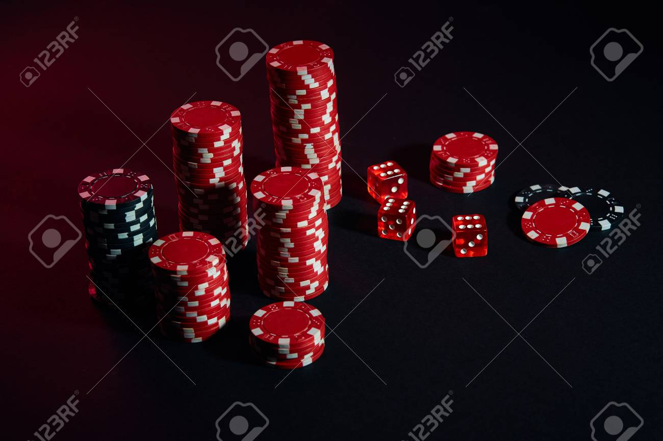 91598174-dice-and-red-and-black-chips-on-dark-background.jpg