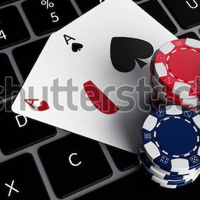 poker-chips-aces-on-laptop-600w-1710450091.webp