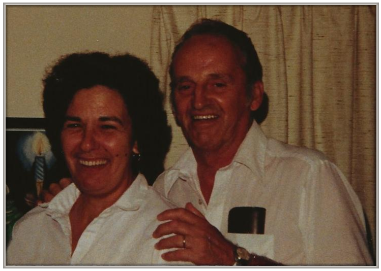 picture of mom and dad for website_cropped 2 with white frame.png