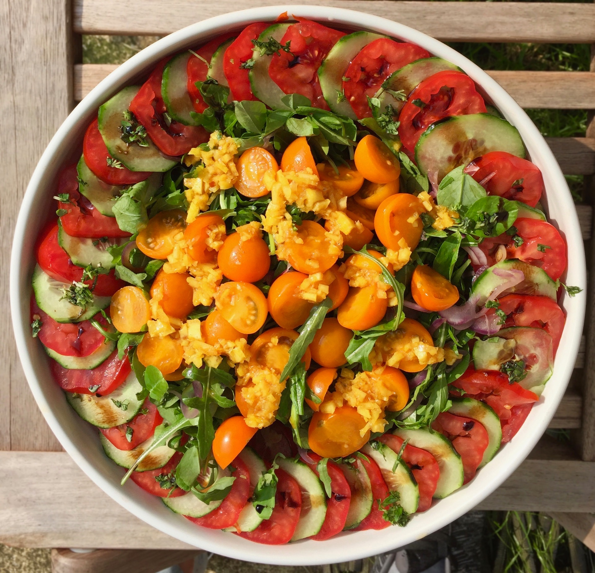 Tomatoes and cucumber with rocket, pickled lemon and basil
