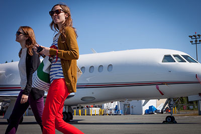girls boarding private jet