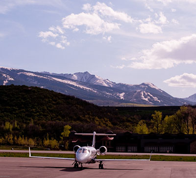 Private jet in mountains