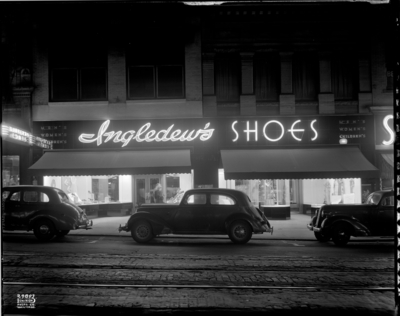 road, cars, vehicles, automobiles, night, shops, stores, street, shoe shop, shoe store, tramway track, building