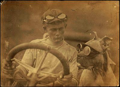 doggles, motorcycle goggles, motorcycle eyewear, man, dog, pet, animal, steering wheel, vintage, old, vehicle