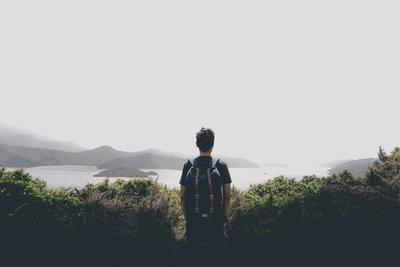 ocean, sea, water, island, hills, fog, view, greenery, man, tourist, backpack, sky