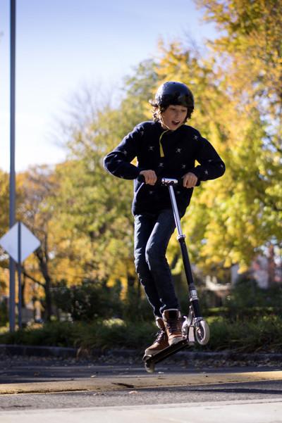 scooter, kid, child, boy, helmet, fun, road, asphalt, trees, sky, clouds