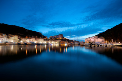 city, cityscape, night, sky, clouds, buildings, river, water, boats, architecture, reflection