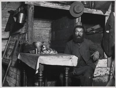 man, beard, table, room, interior, old, vintage, hat, jug