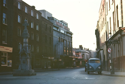 city, town, street, theatre, buildings, traffic, vehicles, monument, old, vintage, road