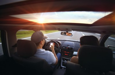 texting, smartphone, technology, driving, couple, dashboard, road, speed, car, automobile, automotive, sun, sun rays, sky