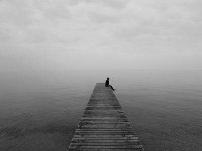 ocean, sea, water, black, white, dock, man, boy, guy, loneliness, sadness, isolation