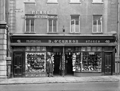 old, black, white, provincial, store, company, building, man, street