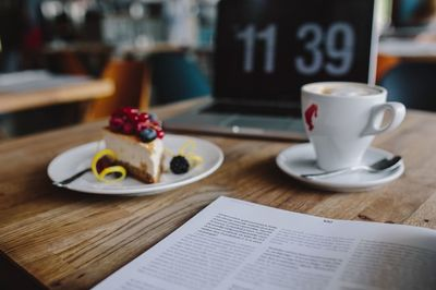 cafe, laptop, table, coffee, cup, cake, dessert, drink, time, clock