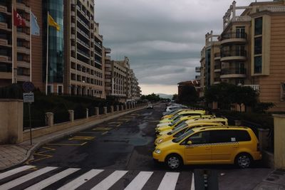 taxi, cabs, street, city, cars, traffic, automobiles, vehicles, yellow, automotive, buildings