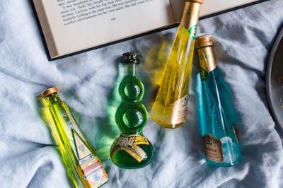 liqueurs, bottles, book, reading, drink, drinks, beverages, alcohol, bed, liquor