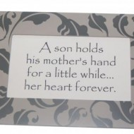 A on holds his mother's hand for a little while... her heart forever