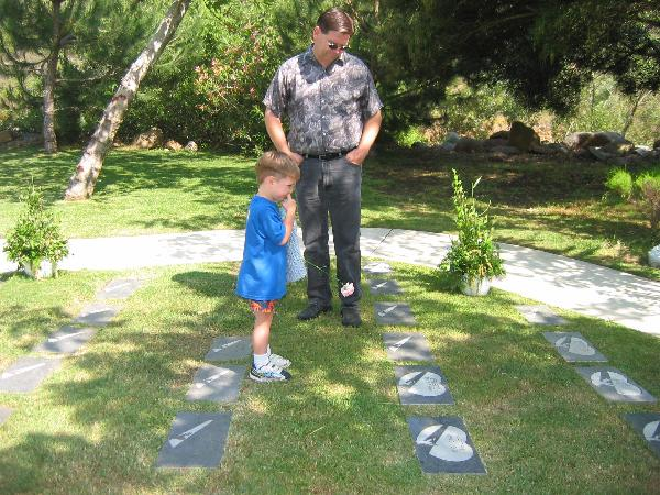 Keegan and his dad at grave 2