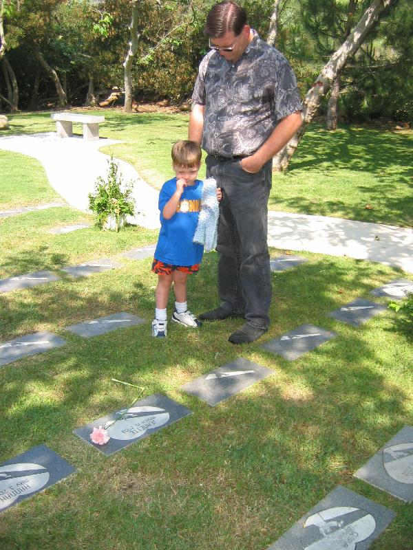 Keegan and his dad at grave 3