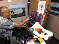 Artist Robert Winans in his studio sitting at an easel painting