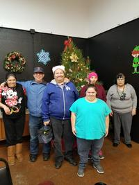 six participants pose at holiday celebration at Santa Maria Applied Abilities Program