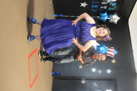 woman in blue dress and man dancing on stage in Santa Maria talent show