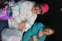 two friends sitting on bench one woman in pink cap at Santa Maria Applied Abilities Program