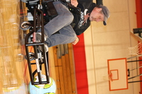 Coach Brian MacLaren in a Strikeforce chair getting into position to hit the ball