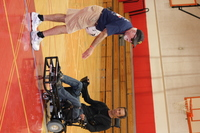 Gustavo and Coach Dan talking about a play while on the basketball court