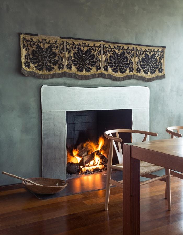 Antique textile bespoke fireplace surround