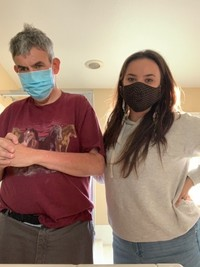 UCP WORK, Inc. Life-Skills Coach Melia Bailey standing with the man she supports wearing facemasks