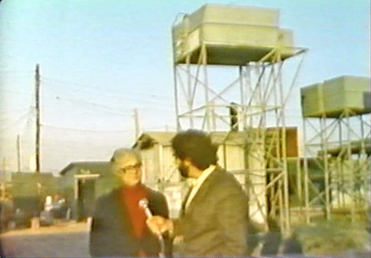 Cyprus: South Side Still Image of Director interviewing Camp Stavrou Psychiatrist