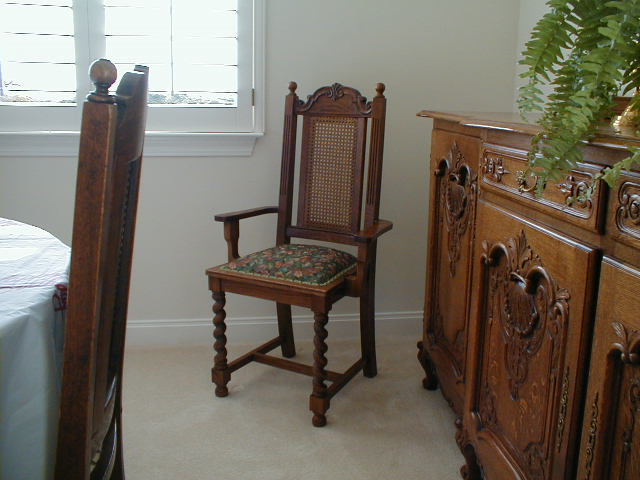 Arm-chair-with_carved-crest-rail_and-rope-twist-legs