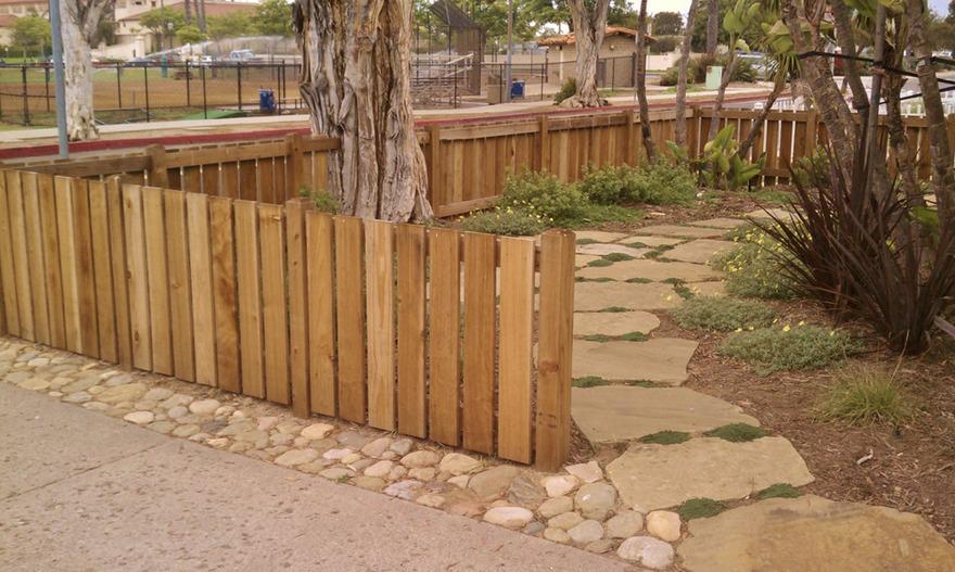 front yard fence stonework plants