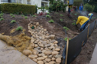 erosion control cobble drainage swale installing mulch