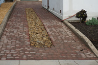 unit paver cobblestone driveway drainage swale stormwater treatment