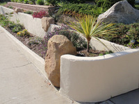 Stucco Walls With Sandstone Boulder Insert