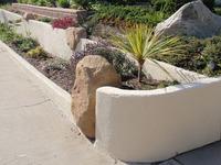 Stucco Walls With Sandstone Boulder Insert