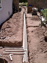 residential irrigation lateral pipe installation trenches