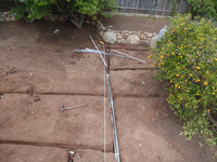 irrigation lateral sprinkler pipes and sandstone terrace planting wall