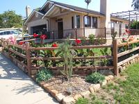 front yard buffalograss lawn stonework split rail fence plantings