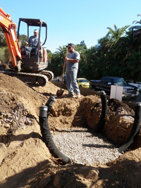 preparing large tree planting holes drainage gravel